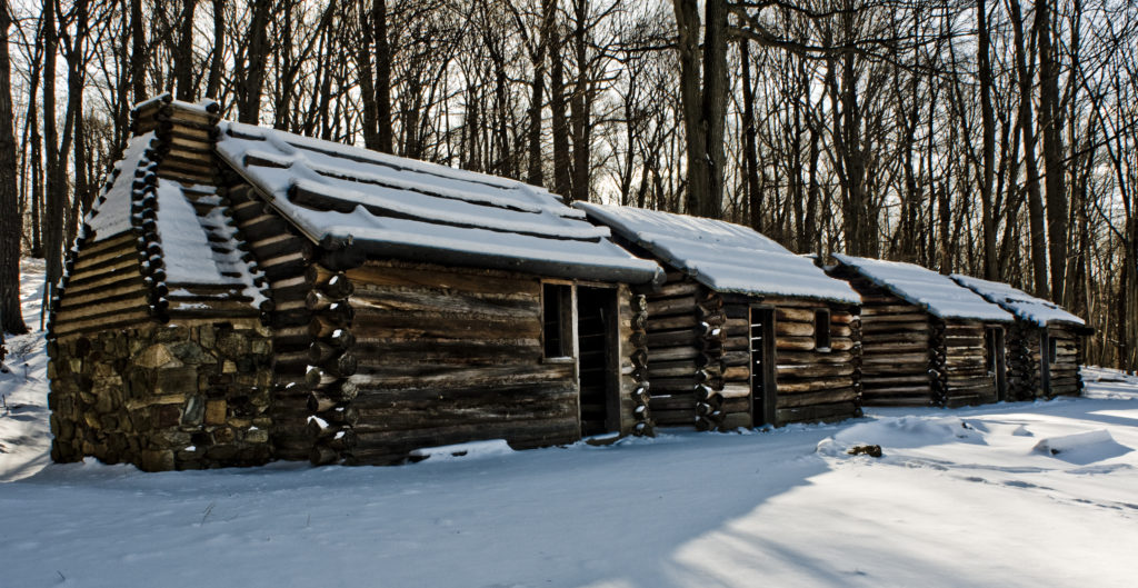 The huts covered in snow at Jockey Hollow, New Jersey.